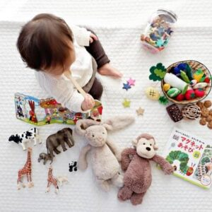 when can the baby start playing with toys
